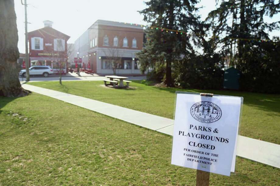A notice on Sherman Town Green on Friday, March 20, 2020, in Fairfield, Conn. Photo: Jarret Liotta / Jarret Liotta / ©Jarret Liotta 2020
