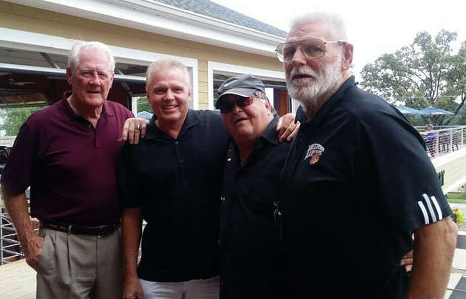 Billy Joe Brockhouse, far right, served as an assistant coach at Edwardsville in baseball from 1990-98 and in boys basketball from 1994-2008. He passed away Thursday at the age of 76.