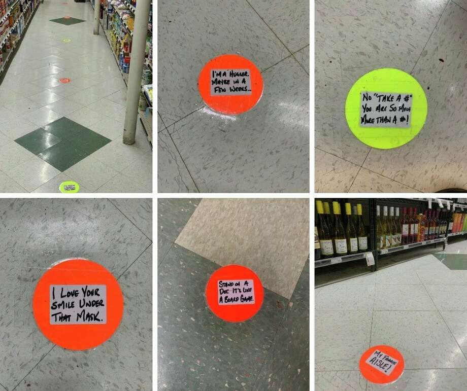 Small dots have been placed on the floor at six foot intervals throughout LaLonde's Market, which gives customers a visual reminder to maintain that distance. (Photo provided/LaLonde's Market)
