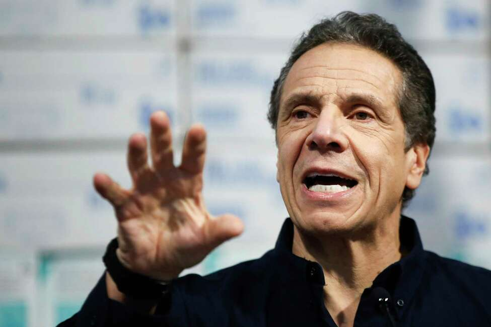 New York Gov. Andrew Cuomo speaks during a news conference against a backdrop of medical supplies at the Jacob Javits Center that will house a temporary hospital in response to the COVID-19 outbreak, Tuesday, March 24, 2020, in New York. Cuomo sounded his most dire warning yet about the coronavirus pandemic, saying the infection rate in New York is accelerating and the state could be as close as two weeks away from a crisis that projects 40,000 people in intensive care.