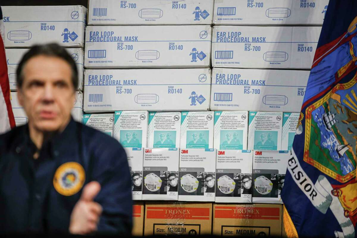 New York Gov. Andrew Cuomo speaks during a news conference against a backdrop of medical supplies at the Jacob Javits Center that will house a temporary hospital in response to the COVID-19 outbreak, Tuesday, March 24, 2020, in New York. Gov. Cuomo sounded his most dire warning yet about the coronavirus pandemic, saying the infection rate in New York is accelerating and the state could be as close as two weeks away from a crisis that projects 40,000 people in intensive care.