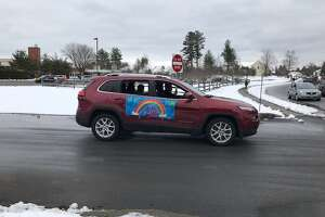 Cars were filled with students, parents and teachers paraded around the neighborhood near Pine Bush Elementary School in Guilderland on Tuesday. As the parade rolled, they honked horns and blared music in an effort to lighten things as the district and the rest of the state and nation confront the spread of the coronavirus.