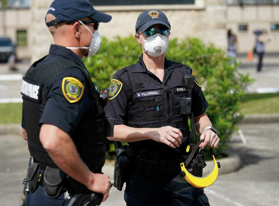PHOTOS: Houston life during a pandemicHouston Police officers wear masks as they work at a coronavirus drive-thru testing area United Methodist Medical Center, 510 West Tidwell, Thursday, March 19, 2020 in Houston. Congresswoman Sheila Jackson Lee, Chair of the Congressional Coronavirus Task Force, held a media conference at the center to urge residents with symptoms of the coronavirus to take free testing.>>>See more for life in Houston during the coronavirus pandemic... Photo: Melissa Phillip, Houston Chronicle / Staff Photographer / © 2020 Houston Chronicle