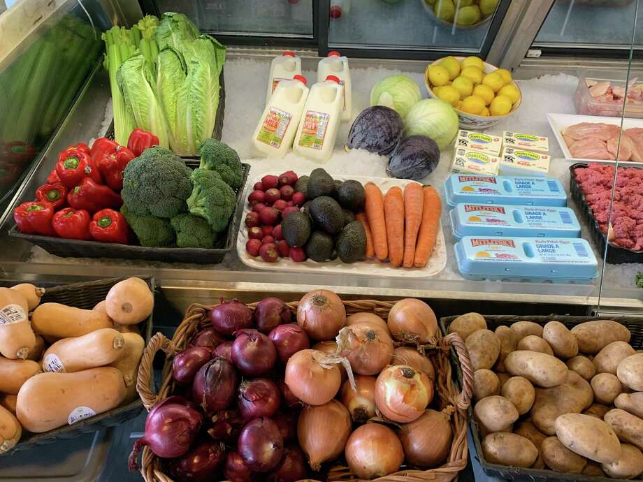 Fresh produce and other grocery items previously not for sale at the Latham seafood cafe and shop Hooked have been added to the stock to give customers an alternative to the supermarket and give Hooked more opportunities for sales, its owner said. Photo: Provided Photo