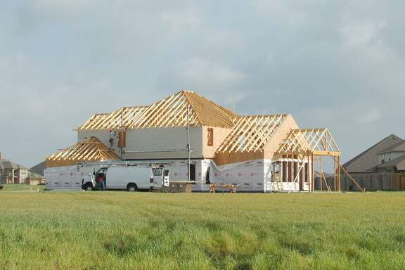 A new house is constructed near League City Parkway and Bay Area Boulevard in in League City, which has plenty of land available for development. Galveston County Judge Mark Henry predicts the 2020 Census will reflect a population surge in the northern part of the county.