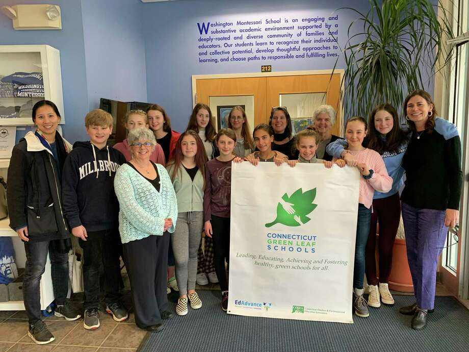 The Washington Montessori School in New Preston was recently certified as a Connecticut Green LEAF School by the Connecticut Outdoor and Environmental Education Association (COEEA). Above are, from left to right, in back, Green Team Director Helen Shu, Liam Schereschewsky, Abby Peklos, Grace Kaoud, Stella Groski, Gigi Bazos, Fiona Foulois, Ella Hartnett, Bianka Laufer and WMS Head of School Carney O'Brien, and in front, Isla Beckstrom, Penny Morrissey, Reagan Colton, Green Team Director Martha Readyoff, WMS Director of Stewardship and Sustainability Nora Hulton and Washington Environmental Council Director Monique Gil-Rogers. Photo: Courtesy Of Washington Montessori School
