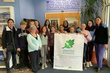 The Washington Montessori School in New Preston was recently certified as a Connecticut Green LEAF School by the Connecticut Outdoor and Environmental Education Association (COEEA). Above are, from left to right, in back, Green Team Director Helen Shu, Liam Schereschewsky, Abby Peklos, Grace Kaoud, Stella Groski, Gigi Bazos, Fiona Foulois, Ella Hartnett, Bianka Laufer and WMS Head of School Carney O'Brien, and in front, Isla Beckstrom, Penny Morrissey, Reagan Colton, Green Team Director Martha Readyoff, WMS Director of Stewardship and Sustainability Nora Hulton and Washington Environmental Council Director Monique Gil-Rogers.