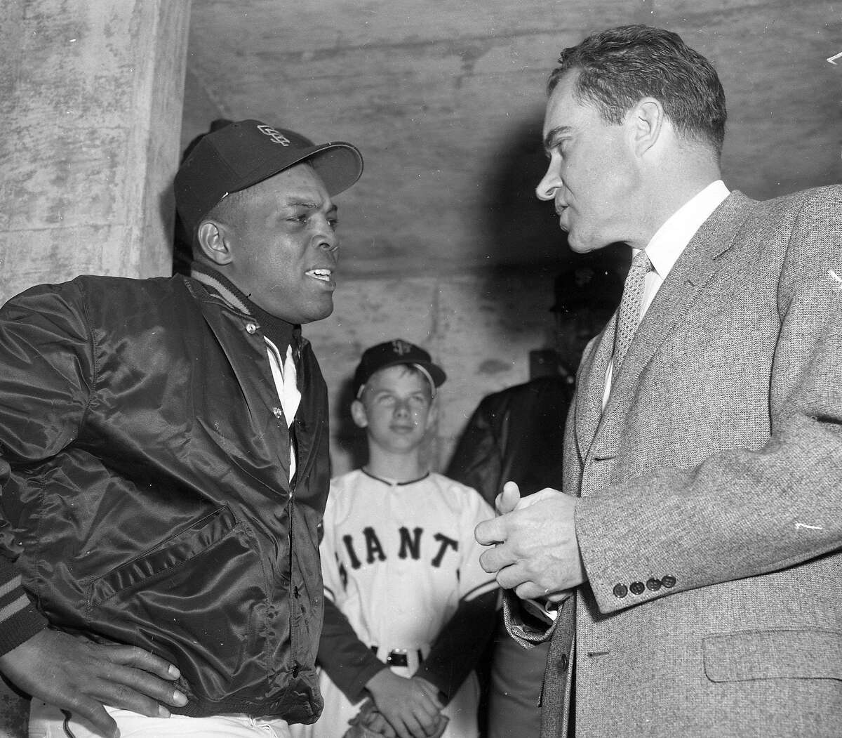 Willie Mays talks baseball with Vice President Richard M. Nixon before opening day at Candlestick Park April 12, 1960