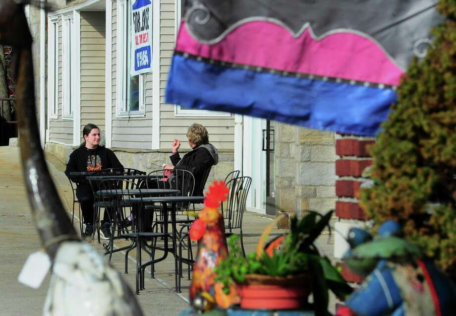 Except for a few people getting some fresh air the coronavirus is causing daily life to slow to a crawl in Milford, Conn., on Tuesday Mar. 17, 2020. Photo: Christian Abraham / Hearst Connecticut Media / Connecticut Post