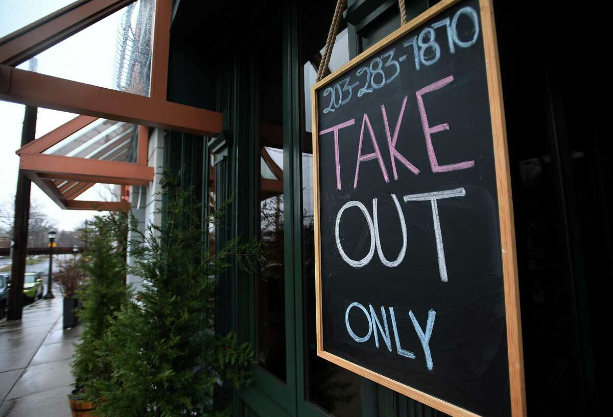 A restaurant sign on River Street in downtown Milford, Conn. on Monday, March 23, 2020.