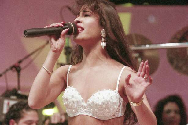 Selena, seen here performing at the Houston Livestock Show and Rodeo, also brought a daring fashion sense to Tejano muisc.