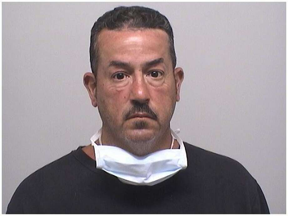 Daniel Camejo, 51, was charged with taking money from seven people, and promising to get them on the Section 8 housing list or to get them moved up the list. Photo: Stamford Police Department / Contributed