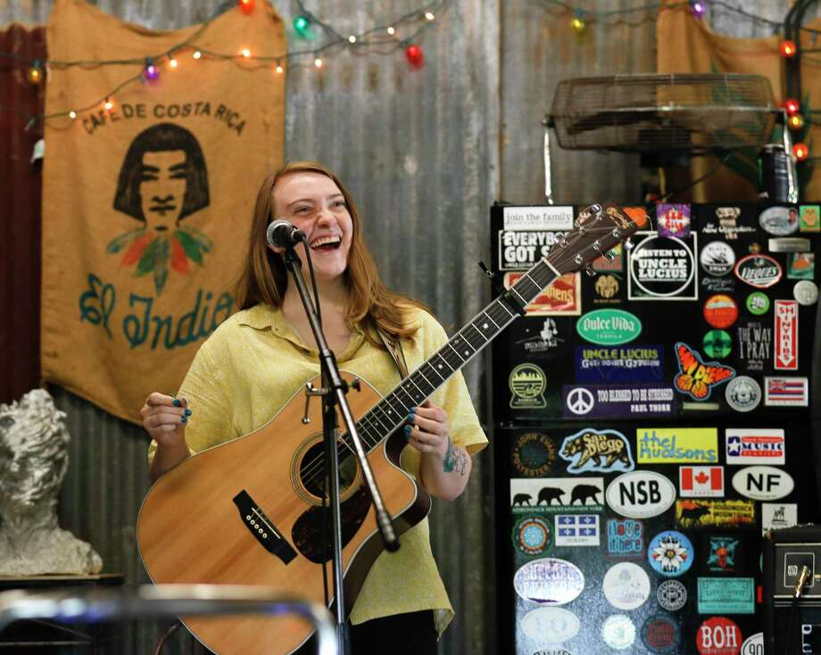 """Maya Kindle, bassist with the band """"The Homegrown Tomatoes,"""" shares a laugh after performing a song during practice, Wednesday, March 19, 2020, in Magnolia. Photo: Jason Fochtman, Houston Chronicle / Staff Photographer / Houston Chronicle  © 2020"""