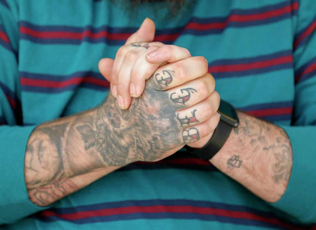 """Tattoo artist Dustin """"Gil"""" Gillihan pose for a portrait at Twisted Angels Art Studio, Tuesday, March 24, 2020, in Conroe."""