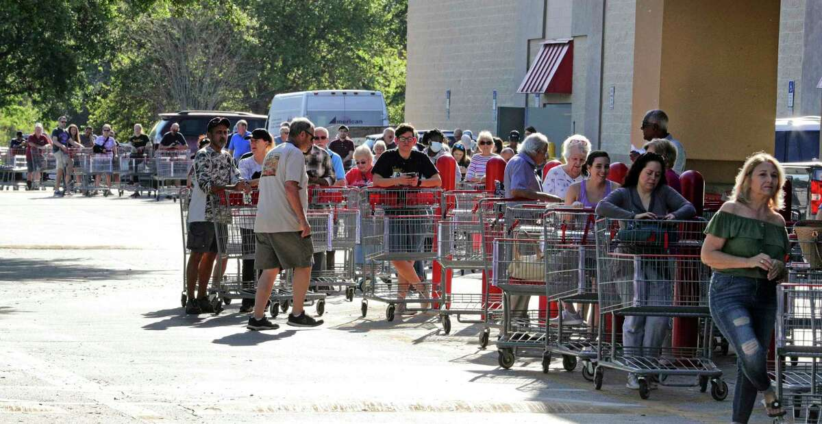 Hundreds of shoppers wait Thursday outside a Costco in Altamonte Springs, Fla., for the store opening. A reader says gathering outside stores is the opposite of what's needed to prevent the spread of this virus.