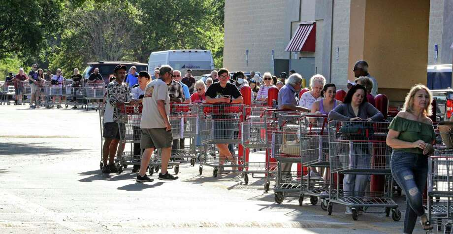 Hundreds of shoppers wait Thursday outside a Costco in Altamonte Springs, Fla., for the store opening. A reader says gathering outside stores is the opposite of what's needed to prevent the spread of this virus. Photo: Joe Burbank /Associated Press / Orlando Sentinel