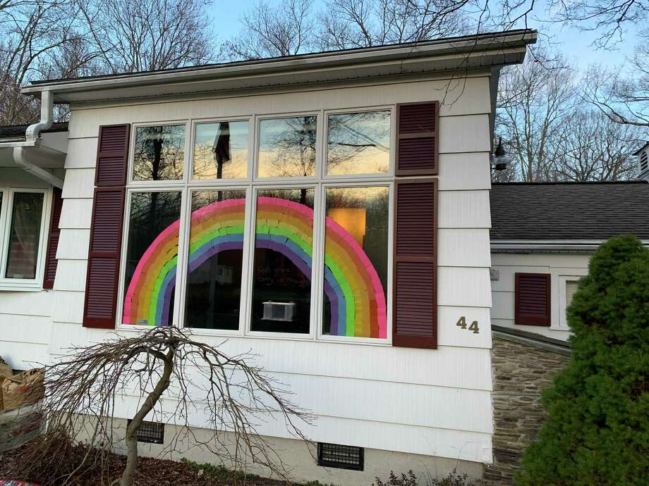 "One Shelton family is trying to inspire hope in what has become desperate times for so many with the spread of the coronavirus throughout the nation and worldwide. Mary McPadden and her daughter, 14-year-old Kate, spent more than two hours Sunday putting a rainbow of hope in their front window. McPadden said her daughter saw that people in Italy were doing this, and the pair saw someone's house in Monroe had a similar rainbow, ""so, we decided to do this also to give people hope."" Photo: Contributed Photo / Connecticut Post"