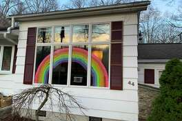 """One Shelton family is trying to inspire hope in what has become desperate times for so many with the spread of the coronavirus throughout the nation and worldwide. Mary McPadden and her daughter, 14-year-old Kate, spent more than two hours Sunday putting a rainbow of hope in their front window. McPadden said her daughter saw that people in Italy were doing this, and the pair saw someone's house in Monroe had a similar rainbow, """"so, we decided to do this also to give people hope."""""""