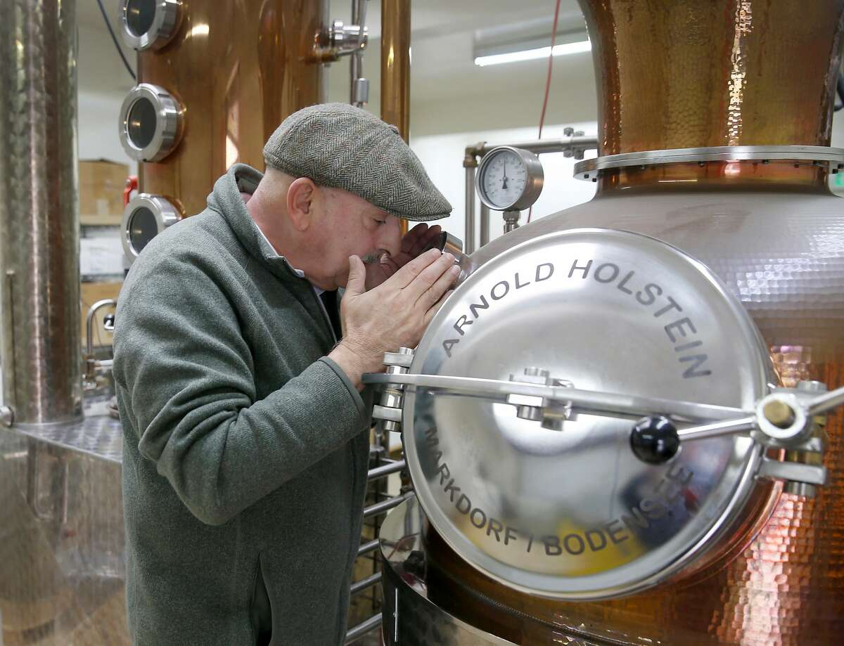 Farid Dormishian observes water being distilled to produce hand sanitizer at his Falcon Spirits distillery in Richmond, Calif. on Tuesday, March 24, 2020. Dormishian suspended production of the spirits during the coronavirus pandemic. The hand sanitizer will be distributed to municipalities like Berkeley and first responders.