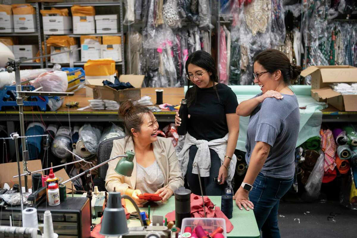 Designer Chloe Dao makes surgical masks in her workspace in the Heights. Dao temporarily closed her 20-year-old namesake boutique, and is now making surgical masks to donate to healthcare workers.