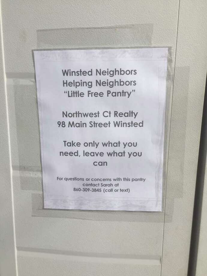 Winsted Neighbors Helping Neighbors has a small food pantry set up outside Northwest Realty on Main Street, where people can take food if they need it and make donations. The group, overseen by founder and resident Sarah Toomey, is making sure people have food during the coronavirus crisis. Photo: Sarah Toomey / Contributed Photo