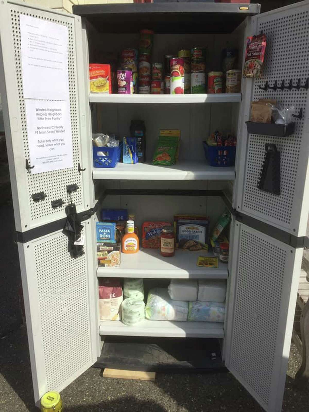 Winsted Neighbors Helping Neighbors has a small food pantry set up outside Northwest Realty on Main Street, where people can take food if they need it and make donations. The group, overseen by founder and resident Sarah Toomey, is making sure people have food during the coronavirus crisis.