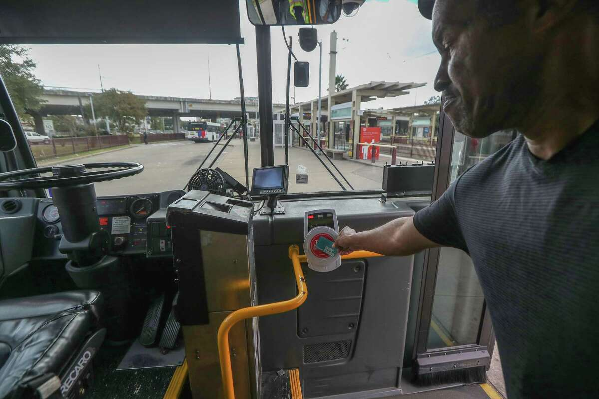 Metropolitan Transit Authority bus riders use Q cards, phone Apps or cash to ride on Nov. 20, 2019, in Houston. Metro waived fares this week to avoid unnecessary contact on transit in light of the coronavirus fears.