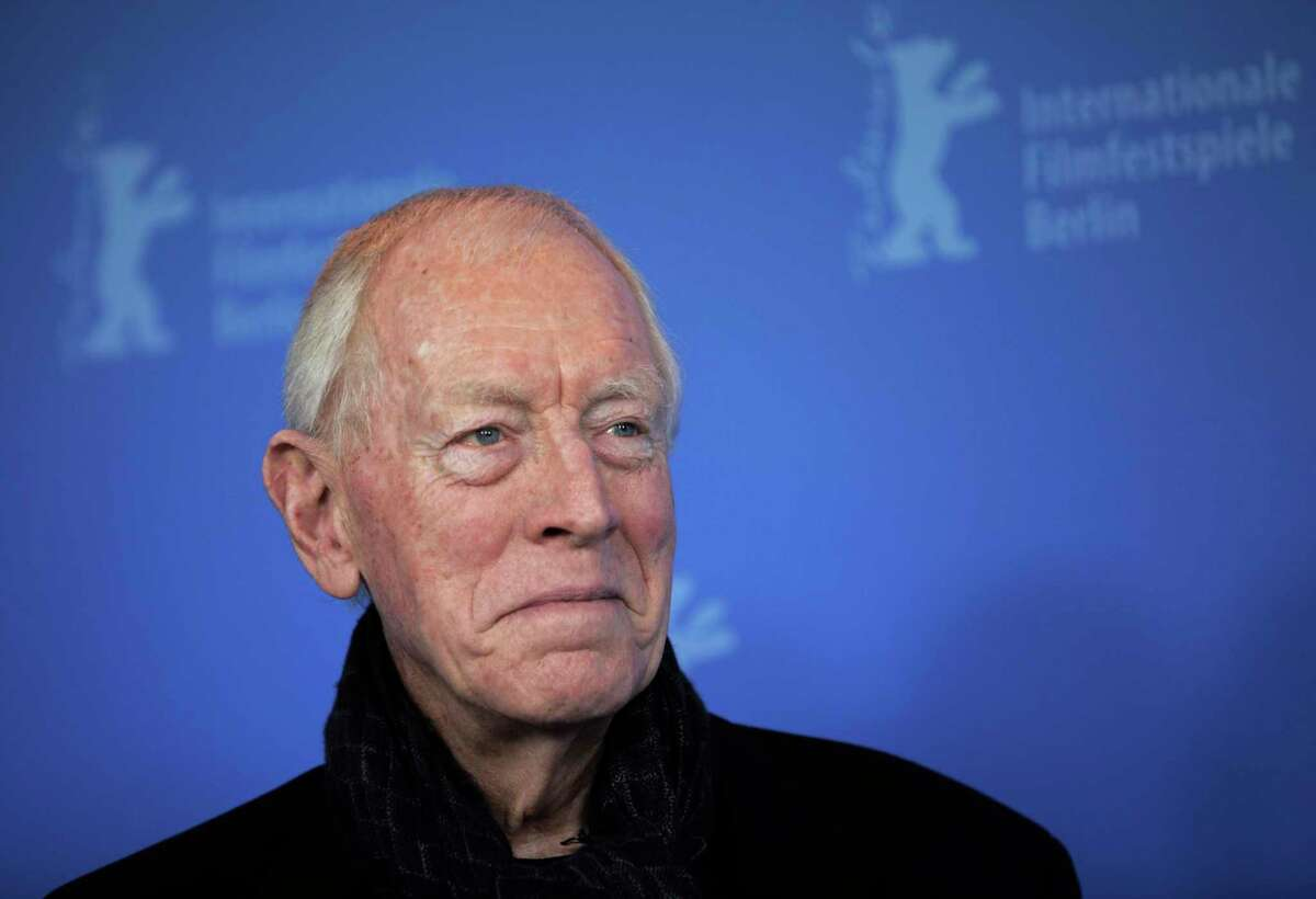 FILE - In this Feb. 10, 2012 file photo, actor Max von Sydow poses at the photo call for the film Extremely Loud and Incredibly Close during the 62 edition of International Film Festival Berlinale, in Berlin. The 2020 TCM Classic Film Festival may have been canceled, but the film-loving folks at Turner Classic Movies have decided to hold the festival on their cable channel. Von Sydow and Ingmar Bergmana€™s a€œThe Seventh Seala€ airs on April 17. (AP Photo/Gero Breloer, File)
