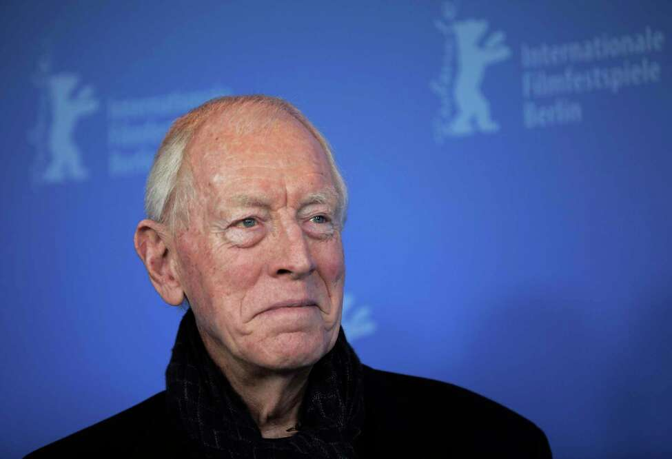 FILE - In this Feb. 10, 2012 file photo, actor Max von Sydow poses at the photo call for the film Extremely Loud and Incredibly Close during the 62 edition of International Film Festival Berlinale, in Berlin. The 2020 TCM Classic Film Festival may have been canceled, but the film-loving folks at Turner Classic Movies have decided to hold the festival on their cable channel. Von Sydow and Ingmar Bergmana€™s a€œThe Seventh Seala€ airs on April 17. (AP Photo/Gero Breloer, File)