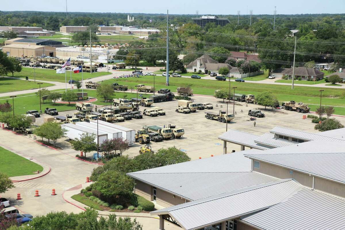 Numerous military vehicles from the Texas National Guard 636th Brigade Support Battalion were parked in the Dayton Community Center parking lot and across the street at the Dayton ISD Transportation facility for use throughout Liberty, Chambers and Jefferson counties during Hurricane Harvey recovery.
