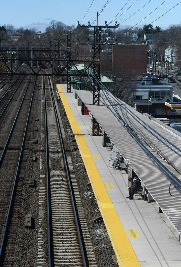 A lone traveler waits for his train at the Greenwich Train Station on Tuesday, March 24, 2020. Since the coronavirus outbreak, Metro-North has seen a sharp decrease in train commuters. Photo: Tyler Sizemore / Hearst Connecticut Media / Greenwich Time