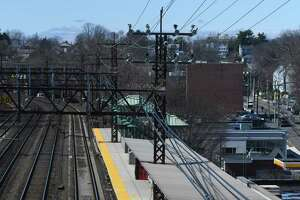 A lone traveler waits for his train at the Greenwich Train Station on Tuesday, March 24, 2020. Since the coronavirus outbreak, Metro-North has seen a sharp decrease in train commuters.