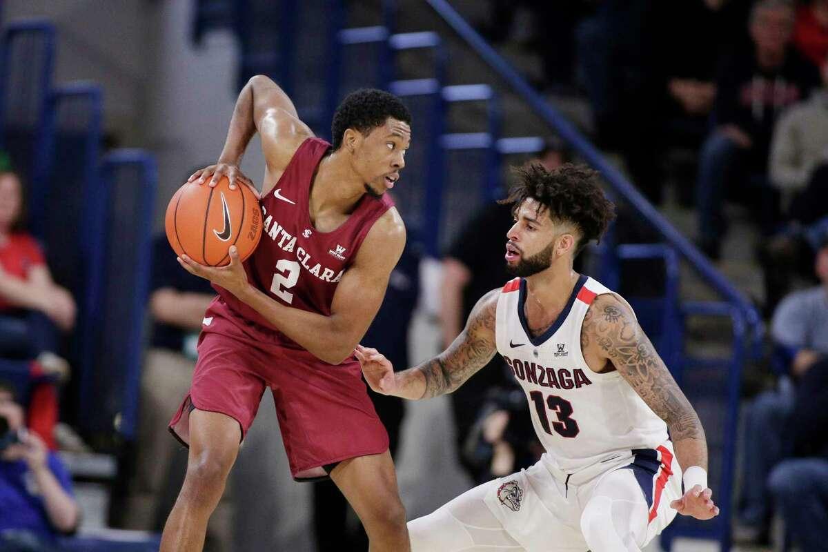 Gonzaga guard Josh Perkins (13) defends Santa Clara guard Tahj Eaddy (2) during the first half of an NCAA college basketball game in Spokane, Wash., Saturday, Jan. 5, 2019. (AP Photo/Young Kwak)