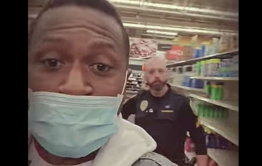 Video posted on YouTube by Jermon Best, of Belleville, shows him and a friend escorted out of Walmart in Wood River by a police officer. Photo: Halo Dave On Youtube