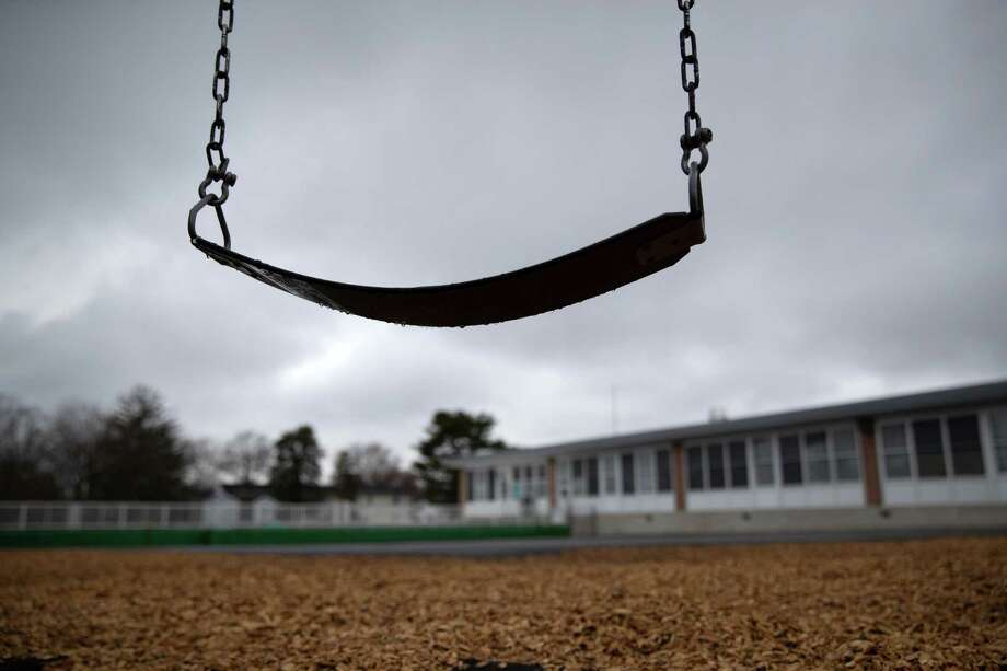 A playground swing hangs at the KT Murphy Elementary School on March 17, 2020 in Stamford, Connecticut. Stamford Public Schools closed to help slow the spread of the COVID-19. Photo: John Moore / Getty Images / 2020 Getty Images