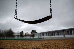A playground swing hangs at the KT Murphy Elementary School on March 17, 2020 in Stamford, Connecticut. Stamford Public Schools closed to help slow the spread of the COVID-19.