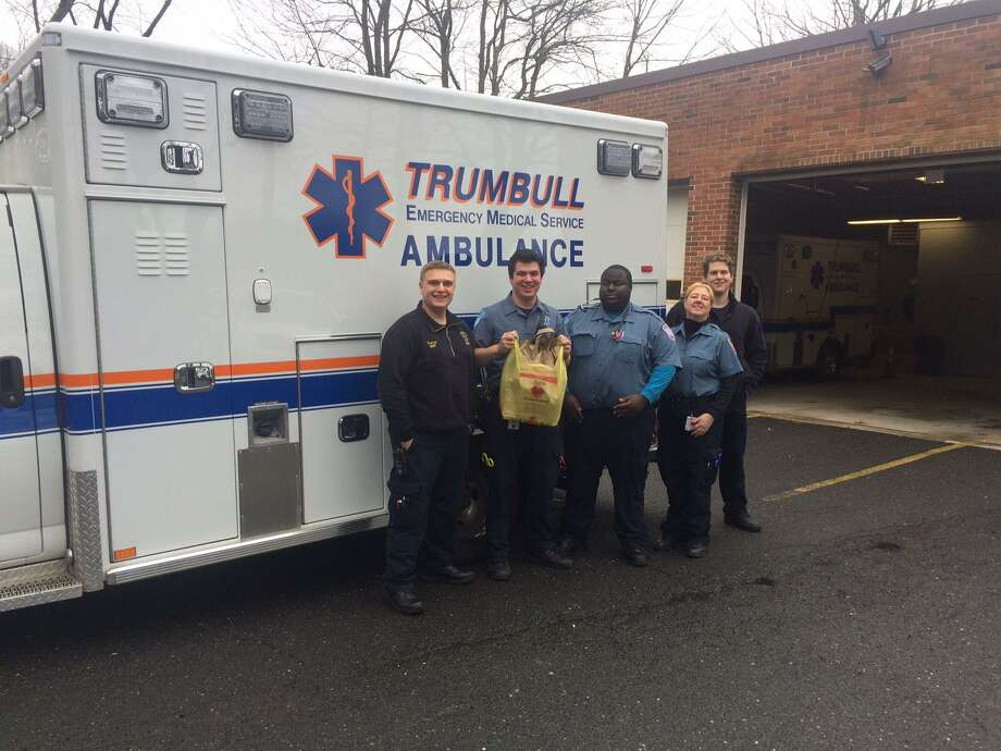 Trumbull EMS workers are collecting donations for the Food Pantry while also seeking personal protective equipment for their own use. Photo: Donald Eng / Hearst Connecticut Media