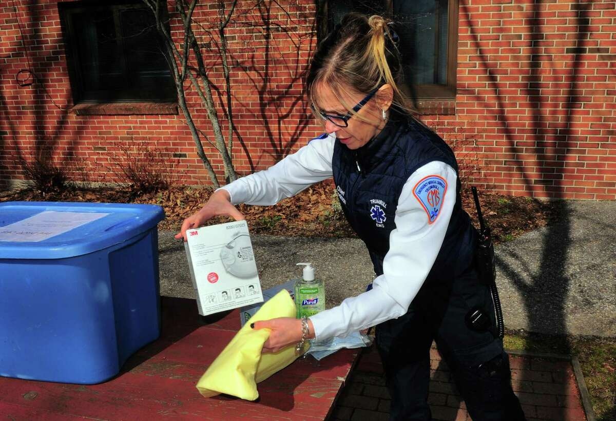 Trumbull Emergency Medical Service's Chief Leigh Goodman shows examples of PPE (Personal Protective Equipment) that has been donated to its headquarters in Trumbull, Conn., on Tuesday Mar. 24, 2020.