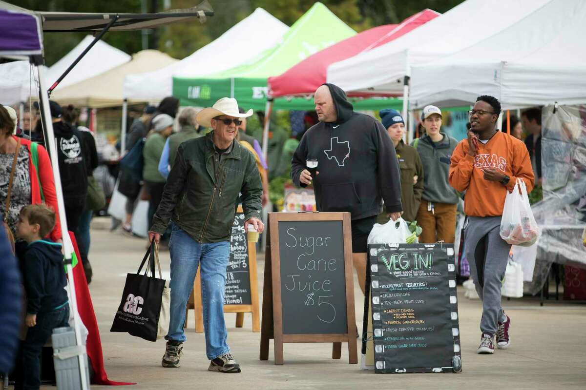 Shoppers make their way around Urban Harvest's Saturday farmers market on Oct. 26, 2019, in Houston.