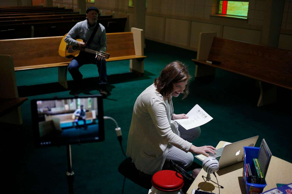 Rev. Molly Shoulta Tucker, and Fredd Bogert, minister of music, rehearse before leading a service at Ridgewood Baptist Church online through Facebook Live in Louisville on Sunday, March 15, 2020. The social network is straining to deal with skyrocketing usage as its 45,000 employees work from home for the first time as the coronavirus spread around the world. (Luke Sharrett/The New York Times)