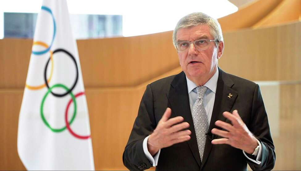 A TV grab from a video released by the International Olympic Committee (IOC) on March 24, 2020 shows IOC President Thomas Bach delivering a statement after the 2020 Tokyo Olympics were postponed to no later than the summer of 2021 because of the coronavirus pandemic sweeping the globe. - Olympic chiefs on March 24, 2020 postponed the 2020 Tokyo Games until next year, a historic move to push back the world's biggest sporting event due to the coronavirus pandemic that is upending global society. (Photo by Handout / AFP) / RESTRICTED TO EDITORIAL USE - MANDATORY CREDIT