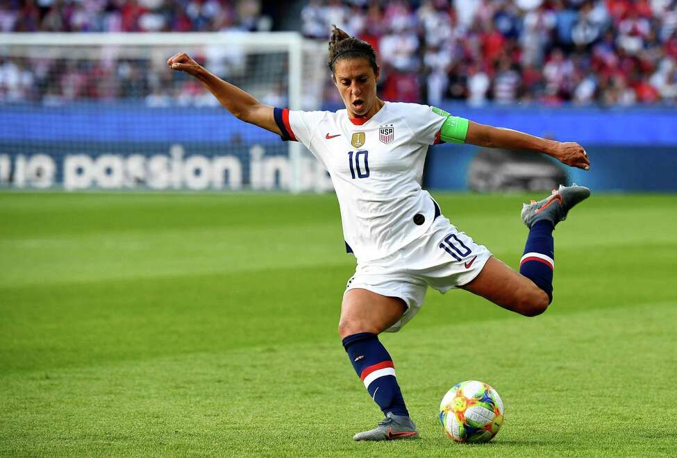 (FILES) In this file photo taken on June 16, 2019 United States' forward Carli Lloyd plays the ball during the France 2019 Women's World Cup Group F football match between USA and Chile, at the Parc des Princes stadium in Paris. - US footballer Carli Lloyd planned to call time on a spectacular career after Tokyo 2020 -- but now that plan is on hold. Lloyd, a two-time women's world player of the year and a two-time World Cup winner, scored the goals that delivered gold to the United States in two Olympics. The 37-year-old said the decision to push back the Games, originally scheduled to run July 24-August 9, to 2021 was the right one in the face of the coronavirus pandemic. (Photo by FRANCK FIFE / AFP) (Photo by FRANCK FIFE/AFP via Getty Images)