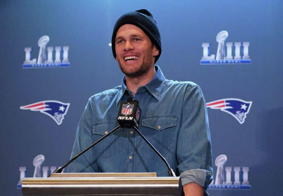 (FILES) In this file photo former New England Patriots quarterback Tom Brady talks to the press during a media availability at the Super Bowl Media Center at the World Congress Center in Atlanta, Georgia on January 31, 2019. - Six-time Super Bowl champion quarterback Tom Brady appears set to join the Tampa Bay Buccaneers as NFL free agency signings were prepared to begin on March 18, 2020.Three-time NFL Most Valuable Player Brady, who turns 43 in August, said Tuesday he was leaving the New England Patriots after 20 seasons with the club under coach Bill Belichick. (Photo by TIMOTHY A. CLARY / AFP) (Photo by TIMOTHY A. CLARY/AFP via Getty Images)