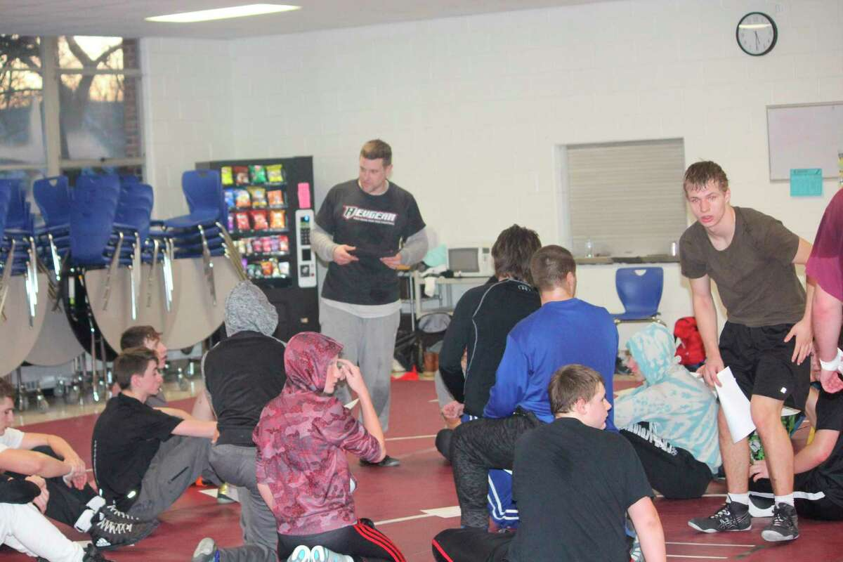 Evart wrestling coach Ben Bryant talks with his team after a practice during the season. (Herald Review file photo)