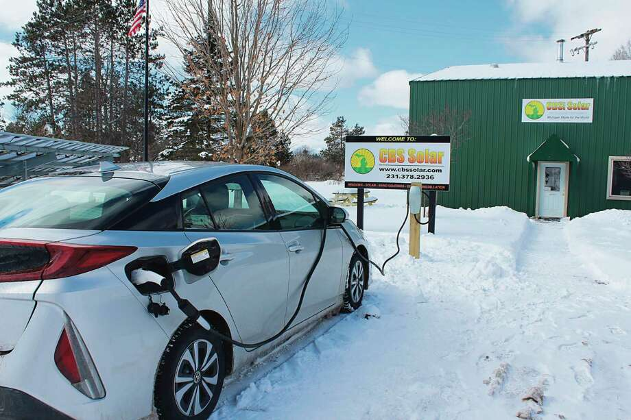 An electric vehicle gets powered up at a new charging station located at CBS solar in Copemich. (Courtesy Photo/Vicki Olsen)