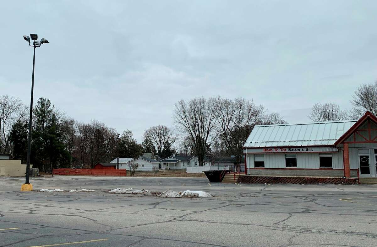 Owners of Ebels General Store in Falmouth, who recently purchased the old Vic's Supermarket property, now have plans to build a new structure that connects to the strip mall on the back side of the property. Property owners within 300 feet of the set back areaare being notified of the plans, which include a request for a variance in the set back requirements. (Herald Review photo/Cathie Crew)