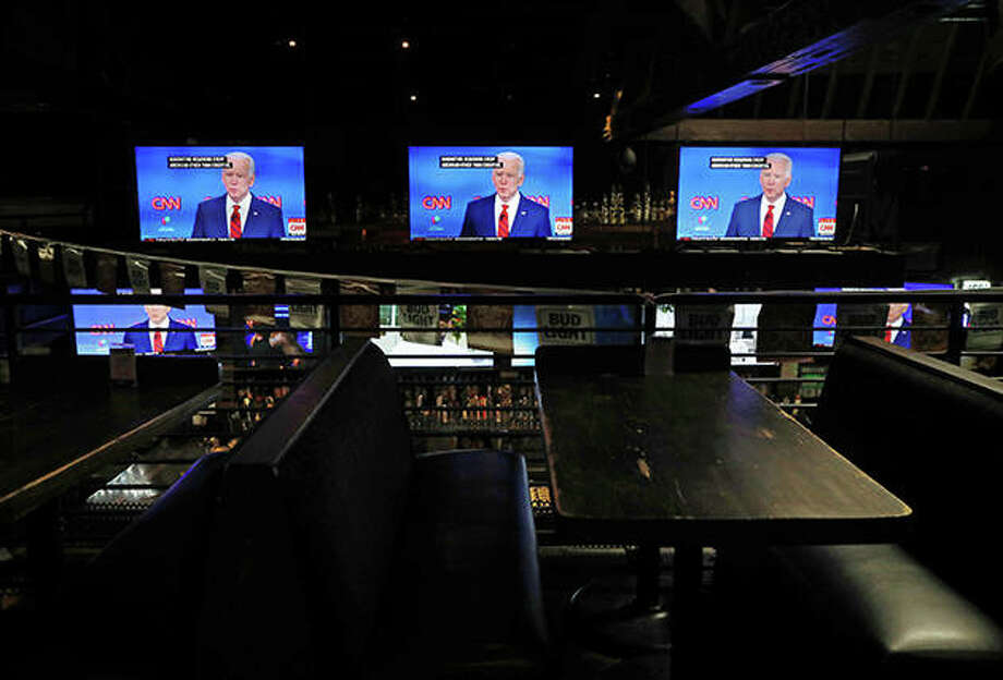Democratic presidential candidate Joe Biden speaks about the coronavirus crisis on a live broadcast to a nearly empty restaurant. Photo: Mario Tama | Getty Images