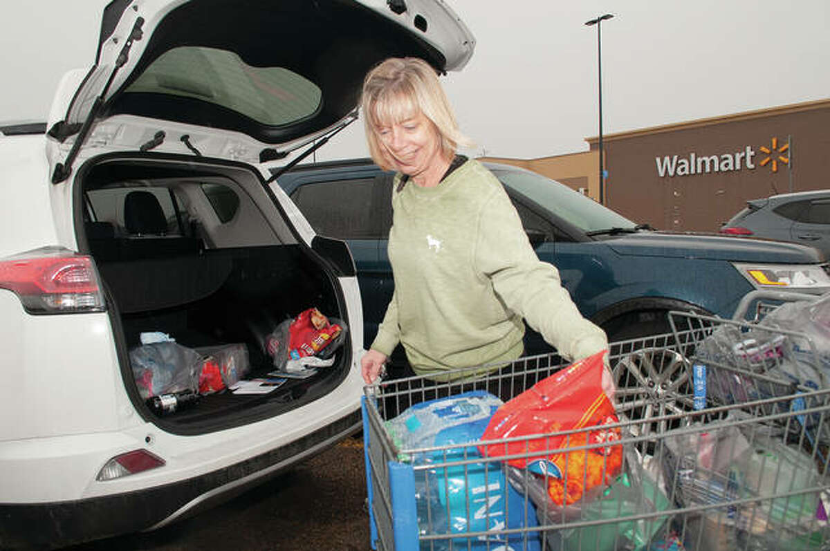 Kim Bowman loads groceries midday Tuesday after shopping at Walmart. Bowman said she has been taking extra precautions and limiting how much she needs to be away from home.