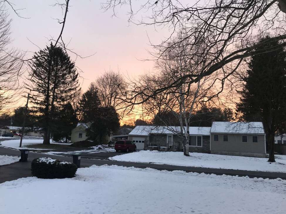Light from the rising sun fills the sky over Glenville on Wednesday. Times Union meteorologist Jason Gough says most of the Capital Region should be spared from the precipitation a coastal storm is delivering to the Northeast.