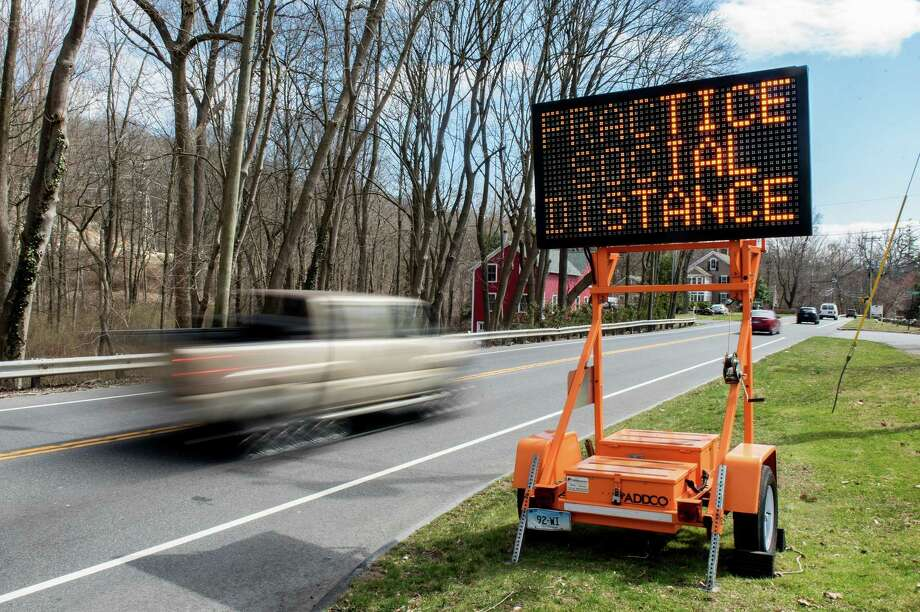 A message on Route 7 near Scribner Hill reminds people to practice social distancing. Photo: Bryan Haeffele /bryanhaeffele.com / BryanHaeffele